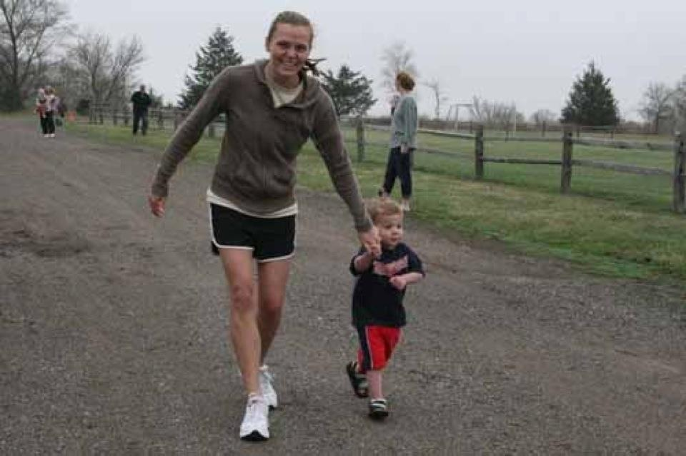 Physical therapist Walking with child Katie Larson - Physical Therapy at OSI